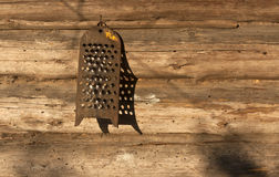 Old grater on log house wall. Stock Photography
