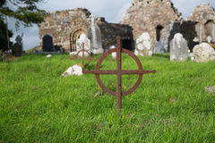 Old grave cross on celtic cemetery in ireland Royalty Free Stock Photo