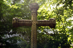 Old grave cross with cobwebs Royalty Free Stock Images