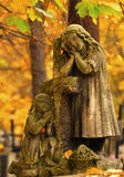Old grave statue. Old style grave statue - two kids praying - Rakowicki cemetery in Kraków Poland stock photography