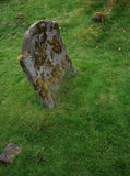 Old grave stone. Grave stone covered in moss, symbolizes failure and decay. Grave is located in Scotland Stock Image