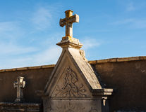 Tomb and cross in the cemetery Royalty Free Stock Image