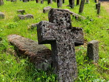 Old grave with a stone cross. Old cemetery with stone monuments Stock Image