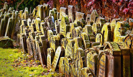Old grave stones piled up against a wall,. Old gravestones piled up against a wall, the cementry was abandoned sometime in the 1800's, 1855 to 1855 so any people royalty free stock photography
