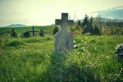 Old grave on traditional European cemetery in Slovakia. Aged cross tomb stone on grave yard in spring Royalty Free Stock Photography