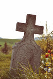 Old grave on traditional European cemetery in Slovakia. Aged cross tomb stone on grave yard in spring Stock Image