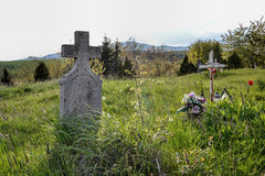 Old grave on traditional European cemetery in Slovakia. Aged cross tomb stone on grave yard in spring Stock Images