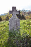 Old grave on traditional European cemetery in Slovakia. Aged cross tomb stone on grave yard in spring Royalty Free Stock Images