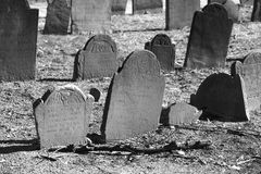 Old graves in bright sunlight. Ancient grave stones in black and white in bright sun light on a beautiful winter's day Stock Images