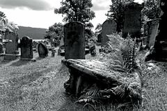 Old graves and gravestones in a cemetery in Scotland Royalty Free Stock Photos