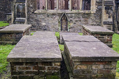 Old graves in Temple Church, Bristol. Graves in an old templar knight church that  is  ruin, but it is still magnificent and beautiful.The historic Temple Church Stock Images