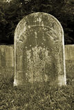 Old Gravestone. With grass in a graveyard Royalty Free Stock Image
