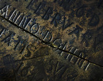 Old Tombstone Background. Detail of tombstone from the 17th Century with the words Anno Domini. A small spider can be seen emerging from a crack Stock Photography