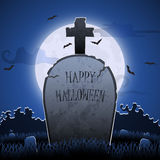 Old gravestone at night with happy halloween word in cemetery Stock Photography