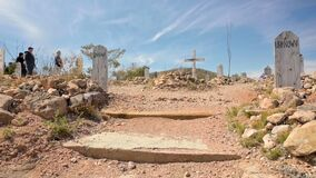 Tourists look at gravestones at Boothill cemetery in Tombstone, Arizona