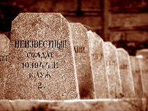 Old gravestones. Rows of tombstones in a military graveyard Royalty Free Stock Images