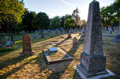 Old gravestones at sunset, Ross Bay Cemetery, Victoria, BC, Canad Royalty Free Stock Photo