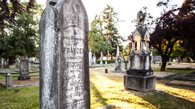 Old gravestones at sunset, Ross Bay Cemetery, Victoria, BC, Canad Royalty Free Stock Photography