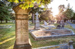 Old gravestones at sunset, Ross Bay Cemetery, Victoria, BC Stock Image