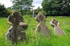 Old gravestones, Weobley. Old stone cross gravestones in St Peter and St Paul churchyard, Weobley, Herefordshire, England, UK, Western Europe Stock Image