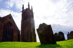 Old graveyard and church in Scotland. Old graveyard in Scotland with shadows of the graves Royalty Free Stock Images