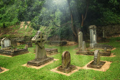 Old graveyard with light Royalty Free Stock Photo