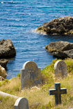 Old graveyard next to the water edge, rocks and sea of Malta Royalty Free Stock Photo