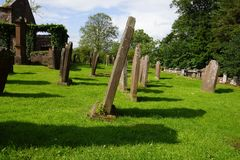 Old graveyard in Scotland. With shadows of the graves Royalty Free Stock Photo