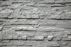 Old gray brick wall Stock Images