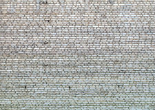 Old gray brick wall as background closeup Royalty Free Stock Photo