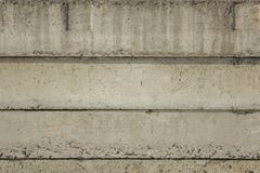 Old gray concrete blocks with damage and deep relief and shadows. horizontal lines. rough surface texture. A old gray concrete blocks with damage and deep relief royalty free stock image