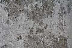 Old gray concrete wall and plaster remains on it. stock photo