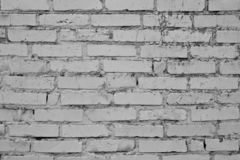 Old gray cracked brick wall. Vintage brick texture. Brick wall background. Vintage house facade. Old concrete grunge texture. Inte royalty free stock photography