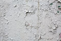 Old gray cracked paint wall background Stock Image