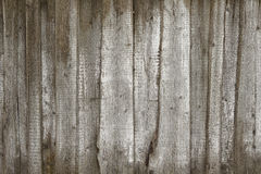 Old gray fence made of wood with white paint strokes royalty free stock photo