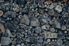Old and gray firewood stack Stock Image
