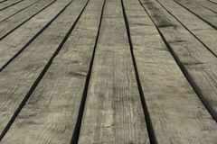 Old gray floorboards with gaps, closeup, background, texture Royalty Free Stock Image