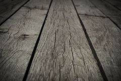 Old gray floorboards with gaps, closeup, background, texture. Surface stock photo