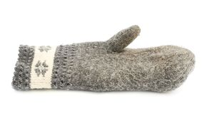 Old gray frayed mitten isolated Royalty Free Stock Images