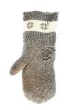 Old gray frayed mitten isolated. Over the white background royalty free stock images