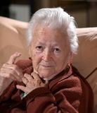Old gray-haired woman in angry gesture Royalty Free Stock Photos