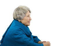 Old gray-haired woman in blue poncho Stock Photos