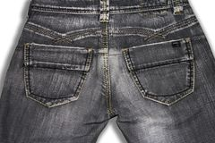 Old gray retro jeans, rear view. stock photo