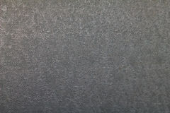 Old gray retro relief plastic texture. Close up Stock Photos