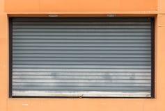 Old gray roller shutter door Stock Photography
