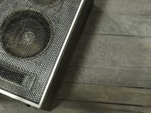 Old gray speaker on a gray background. stock photo