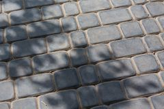 Cobbles. The old gray stone cobbles royalty free stock photos