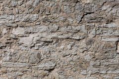 Old gray stone wall, background Royalty Free Stock Image