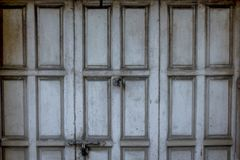The old gray wood door was closed. royalty free stock photo