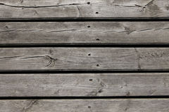 Old gray wood planking. With black holes stock photo